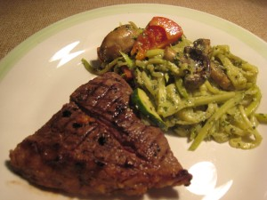 Basil pesto zucchini pasta served with juicy steak